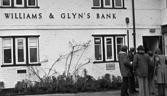 "BLACK AND WHITE ONLY File photo dated 25/02/77 of the then Williams and Glyn's bank in the Cheshire village of Prestbury, near Macclesfield, as the Church of England's investment arm is to have a stake in the running of 314 bank branches being hived off by state-backed Royal Bank of Scotland as part of a £600 million deal, under the deal, the Williams & Glyn business will return to the high street as a ""challenger bank"" to the major players in the industry, with a particular focus on small business banking - a sector seen as vital to the UK's recovery."