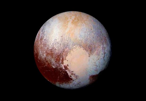 This NASA's photo of Pluto was made from four images from New Horizons' Long Range Reconnaissance Imager (LORRI) combined with color data from the Ralph instrument in this enhanced color global view released on July 24, 2015. The images, taken when the spacecraft was 280,000 miles (450,000 kilometers) away, show features as small as 1.4 miles (2.2 kilometers). REUTERS/NASA/JHUAPL/SwRI/Handout